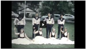 A 1950s Douglas County High School square dancing team of four boys and four girls poses together in their dancing costumes.